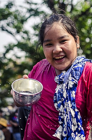 A girl with a traditional blessing bowl during Songkran water festival celebrating Thai New Year, Chiang Mai, Thailand, Southeast Asia, Asia