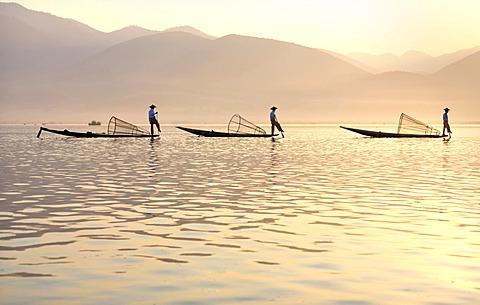 Intha leg rowing fishermen at sunset, Inle Lake, Shan State, Myanmar (Burma), Asia
