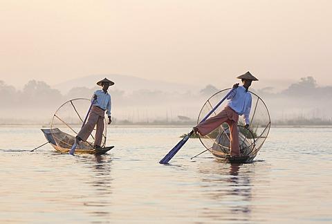 Intha leg rowing fishermen at dawn on Inle Lake, Shan State, Myanmar (Burma), Asia