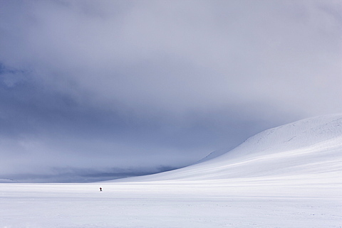 Lone figure skis across Rondane National Park, Norway, Scandinavia, Europe