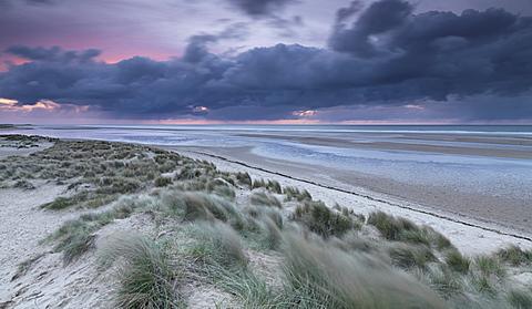 Dramatic conditions at twilight at Holkham Bay, Norfolk, England, United Kingdom, Europe