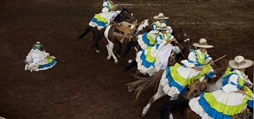 An Amazona rider from Estrellas de la LLanura team stands on the ground after falling from her horse as she competes in an Escaramuza women's rodeo in Chalco on the outskirts of Mexico City, May 10, 2008. Escaramuzas are similar to US rodeos, where female