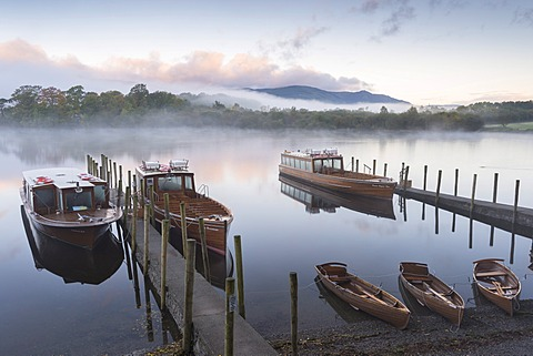 Boats moored on Derwentwater near Friar's Crag in autumn, Keswick, Lake District National Park, Cumbria, England, United Kingdom, Europe