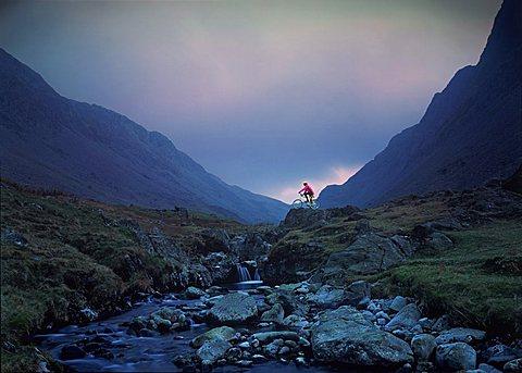 Cyclist on mountain bike, Honister Pass, The Lake District, Cumbria, England, United Kingdom, Europe