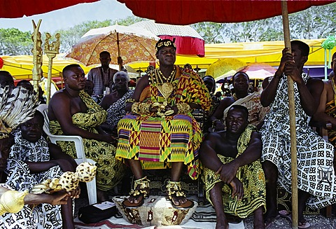 Ashanti (Asante) tribe chief, adorned with jewellery of local gold, at a tribal feast at Accra in Republic of Ghana, West Africa