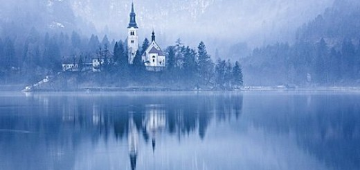 Lake Bled at dawn in winter with Assumption of Mary's Pilgrimage Church, Slovenia, Europe