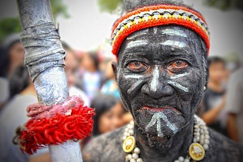 Man holding a spear at Ati Atihan festival, Kalibo, Aklan, Panay Island, Visayas, Philippines