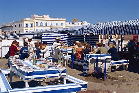 Open air fish restaurants and stalls by the sea to grill fresh fish, Essaouira, Morocco, North Africa, Africa