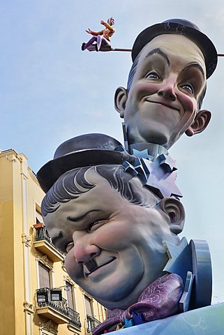 Spain, Valencia Province, Valencia, Papier Mache versions of Laurel and Hardy in the street during Las Fallas festival.