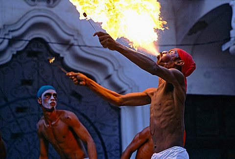 An Afro-Cuban dancer spitting fire at a festival of Afro-Cuban Culture in Guanabacoa just east of Havana, Cuba