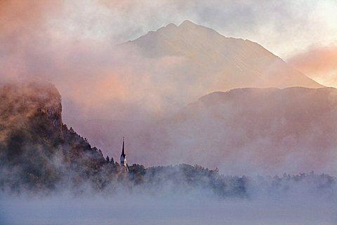 St. Martin's Church on shore of Lake Bled at dawn, Bled, Gorenjska, Julian Alps, Slovenia, Europe