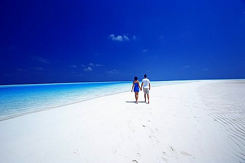 Couple walking on the beach, Maldives, Indian Ocean, Asia
