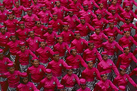 Overhead view of men marching in National Day Parade, Kuala Lumpur, Malaysia, Southeast Asia, Asia