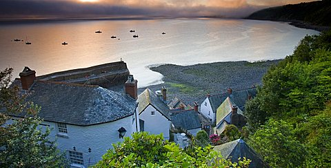 Fog obscures the summer sunrise at Clovelly in Devon, England, United Kingdom, Europe