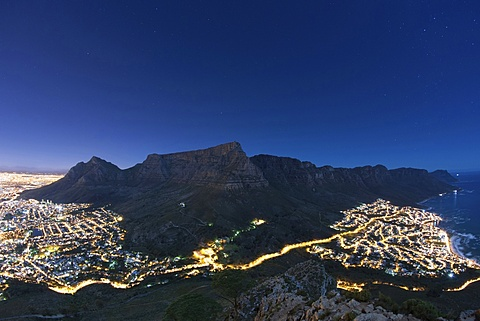 Table Mountain and Cape Town in moonlight.