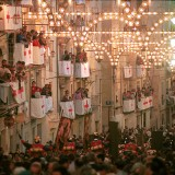 Alcoy,Alicante,Spain - Evening street scene during the annual Moors and Christians celebrations