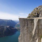 Man standing on Preikestolen (Pulpit Rock) above fjord, Lysefjord, Norway, Scandinavia, Europe