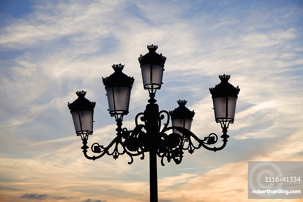 Medina Sidonia, Andalusia, Spain, A Light Post With 5 Lamps On It