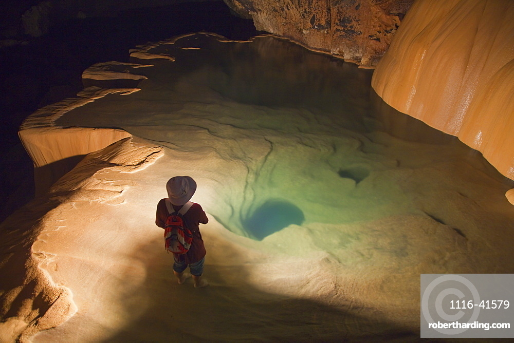 A Filipino Tour Guide Holds A Lantern Inside Sumaging Cave Or Big Cave Near Sagada, Luzon, Philippines