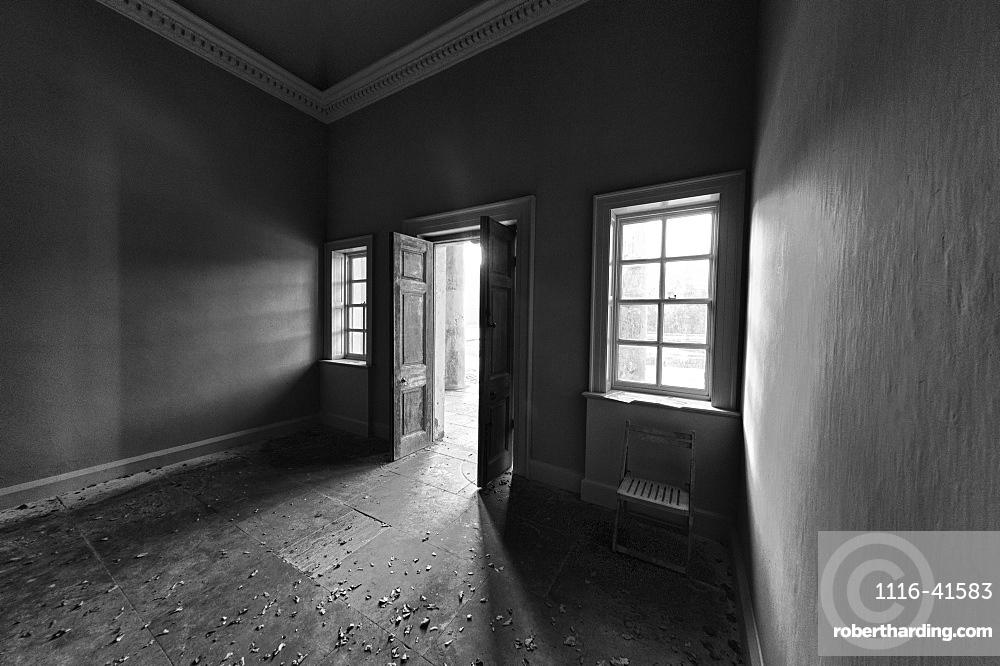Light Shining Into A Dark Room Through An Open Door, North Yorkshire, England
