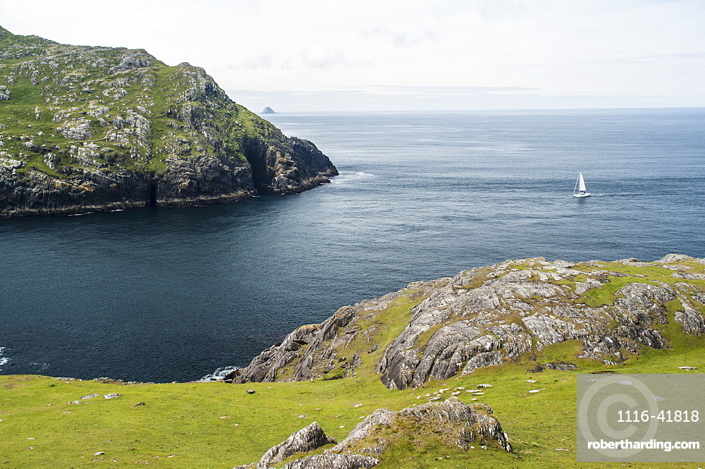 Yacht sailing into dursley sound, Beara peninsula, county kerry, ireland