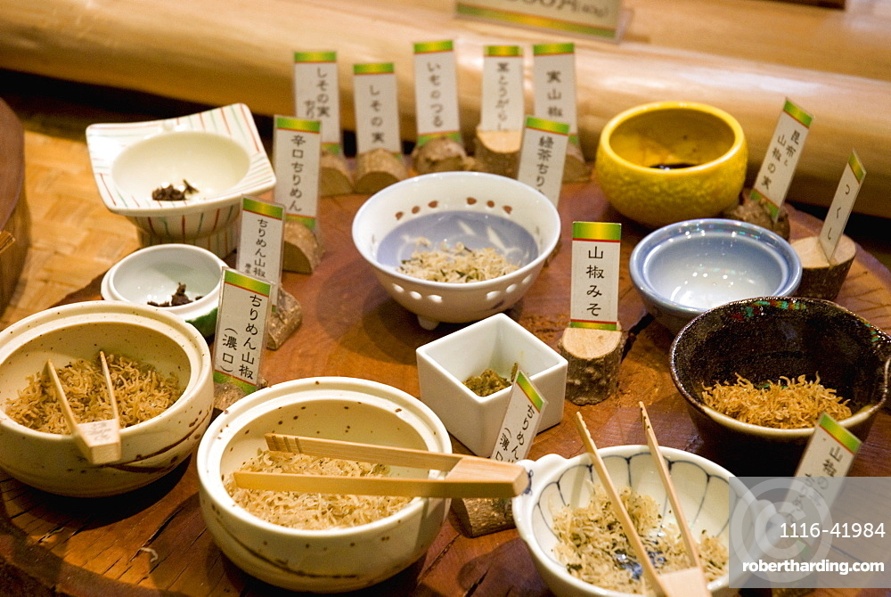 Tray of various traditional japanese dishes on a street market, Kyoto japan