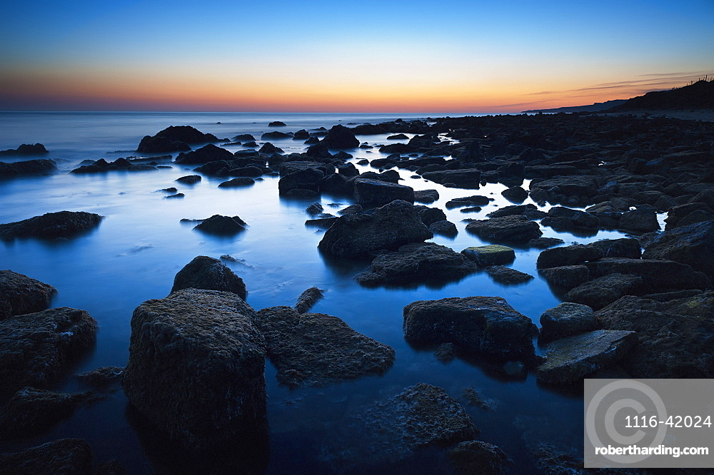 Rocks In The Tranquil Water Along The Coast At Sunset, Tarifa, Cadiz, Andalusia, Spain