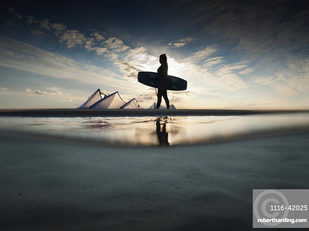 A Kitesurfer Walks Along The Beach At Sunset, Tarifa, Cadiz, Andalusia, Spain