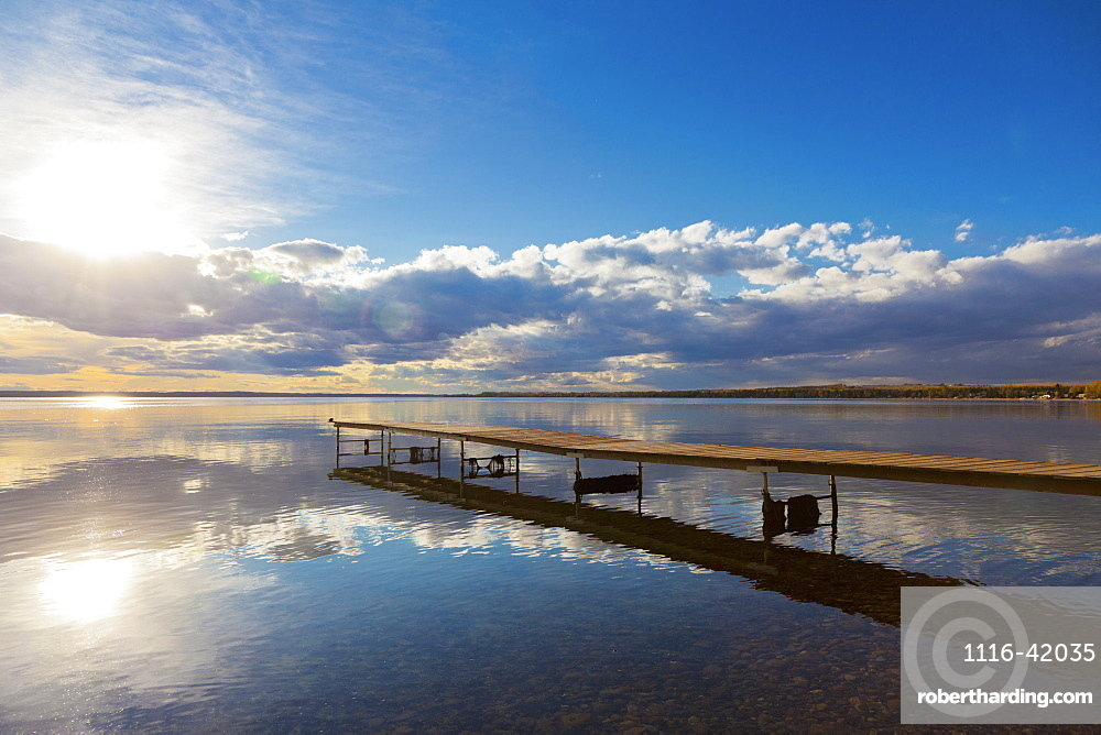 A Dock Leading Out Into The Lake At Sunrise, Pigeon Lake, Alberta, Canada