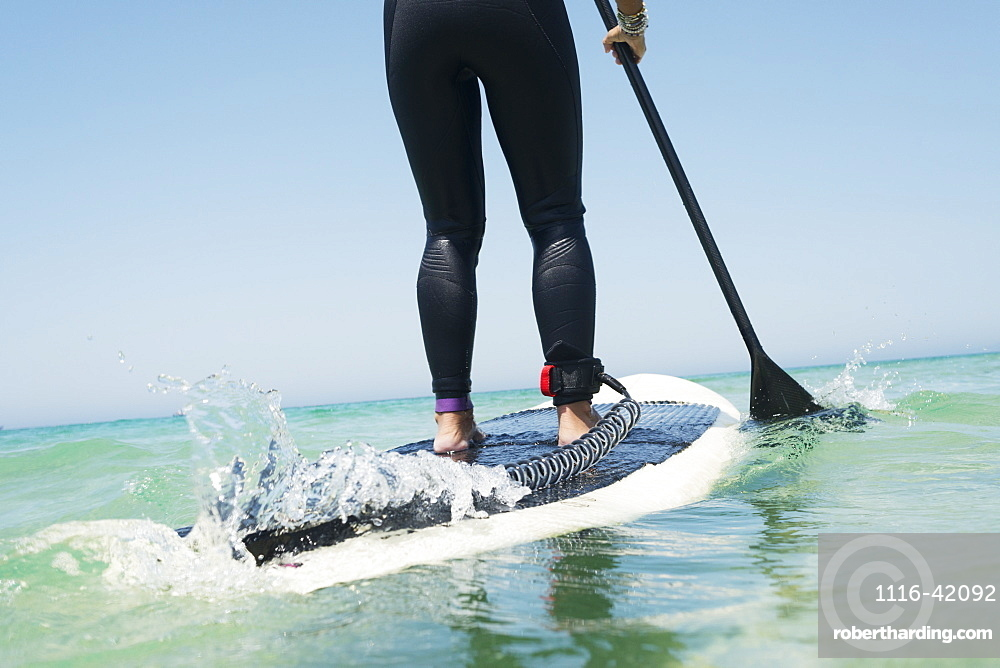 Paddling on a surfboard, Tarifa cadiz andalusia spain
