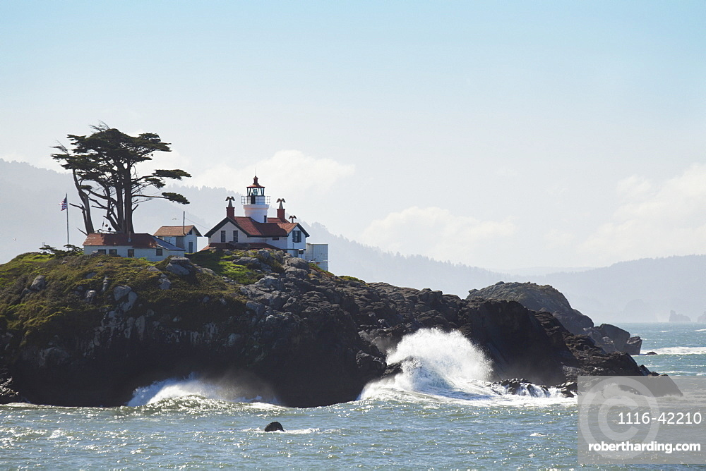 Waves Of The Pacific Ocean Crashing Into The Oregon Coast And A Lighthouse, Oregon, United States Of America