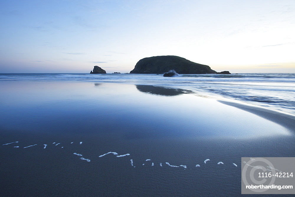 Pacific Ocean And Coast Of Oregon With A Large Rock At Sunset, Oregon, United States Of America