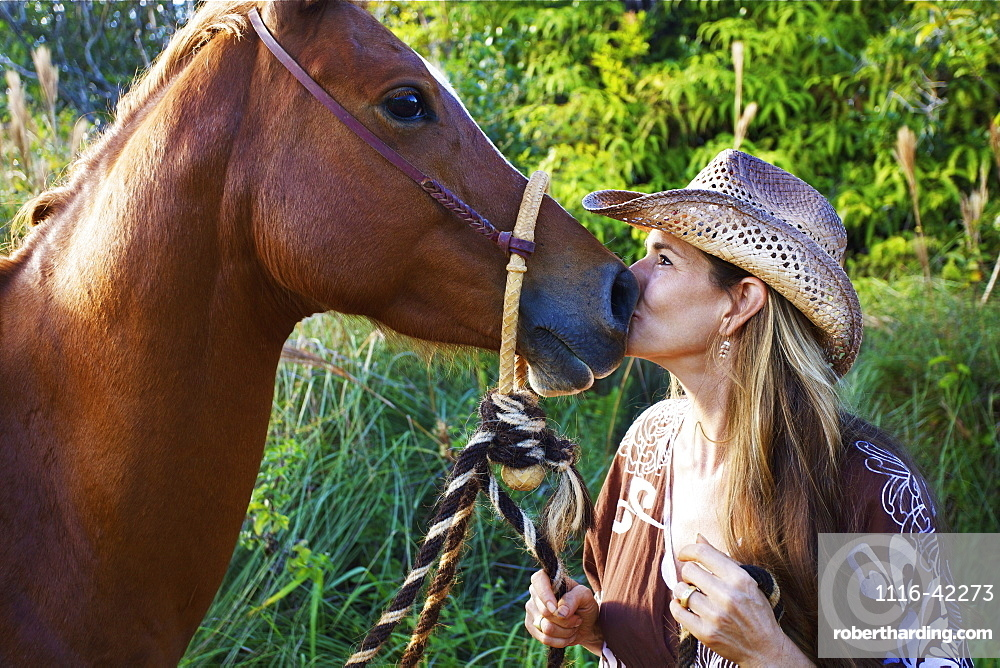 A Woman Kiss The Nose Of A Horse, Hawaii, United States Of America