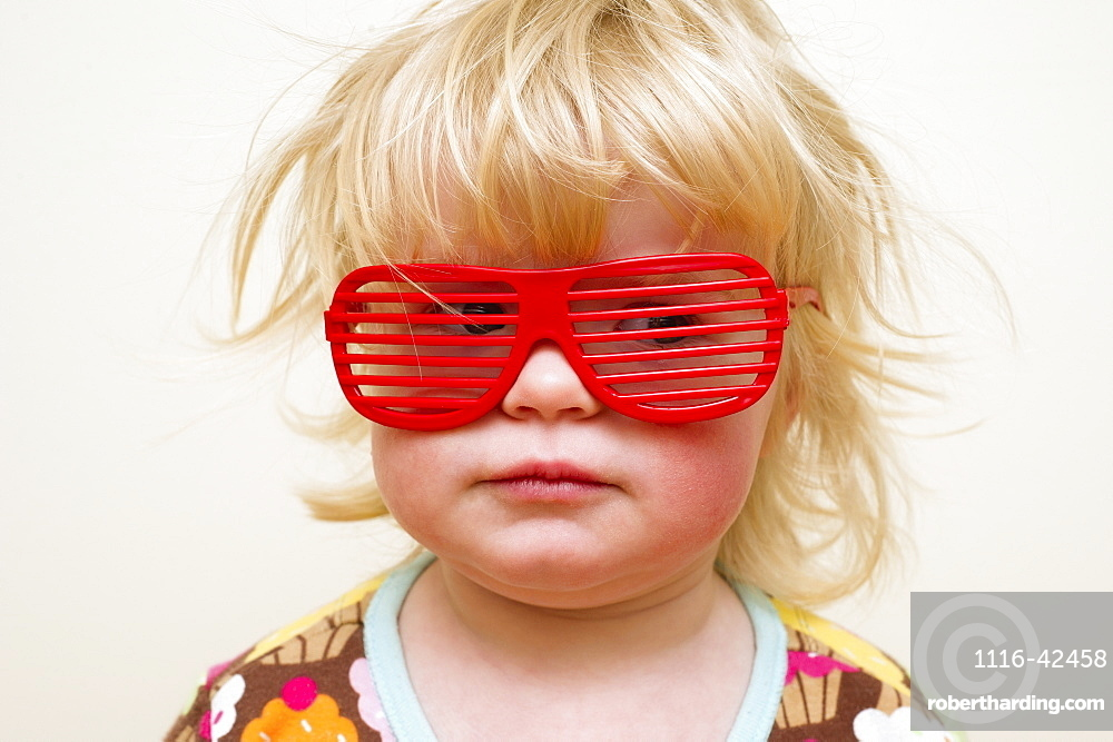 A Young Girl With Funny Red Eyeglasses, Alberta, Canada