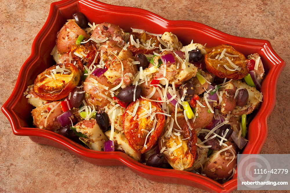 Food - Baked red potatoes with sun-dried tomatoes, Kalamata olives, red onions, red bell pepper, green onions (scallions) and grated Parmesan cheese.