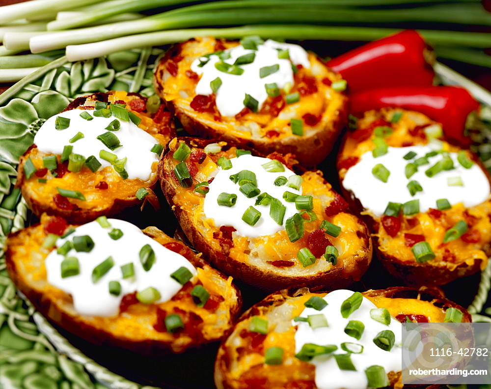 Food - Twice-baked Potatoes with Bacon, garnished with chopped green onions (scallions), enchilada sauce and red chili peppers.