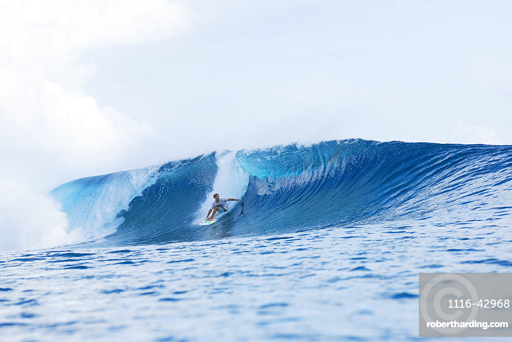 Surfer Riding Perfect Waves In The South Pacific, Tahiti, French Polynesia