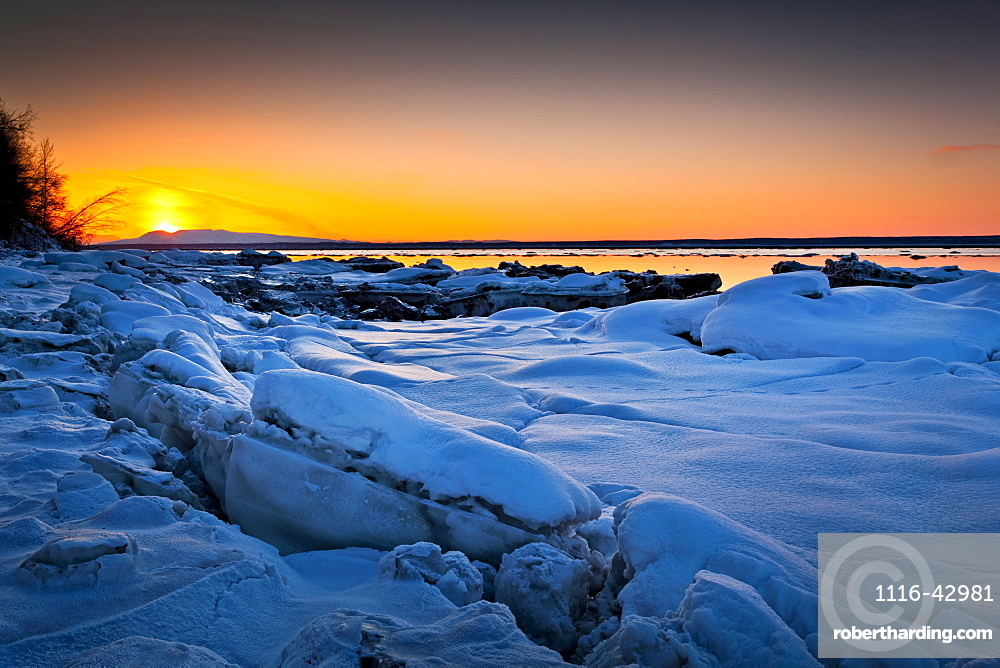 Sunset At Knik Arm In Winter, With Frozen Coast In The Foreground, Chugiak, Alaska, United States Of America
