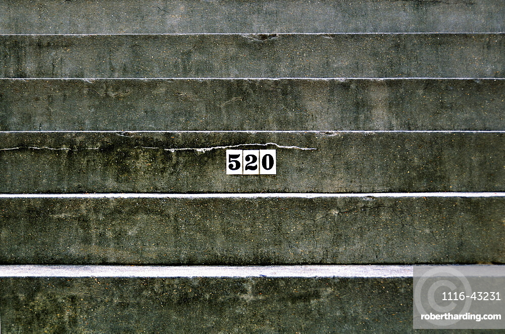 Louisiana, New Orleans, Detail Of An Apartment Address On A Concrete Staircase.