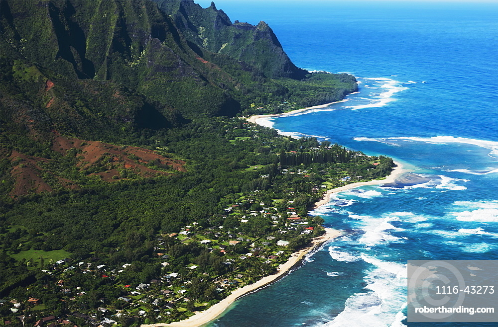 Rugged Mountains Along The Coastline And The Surf Meets The Beach, Haena, Hawaii, United States Of America