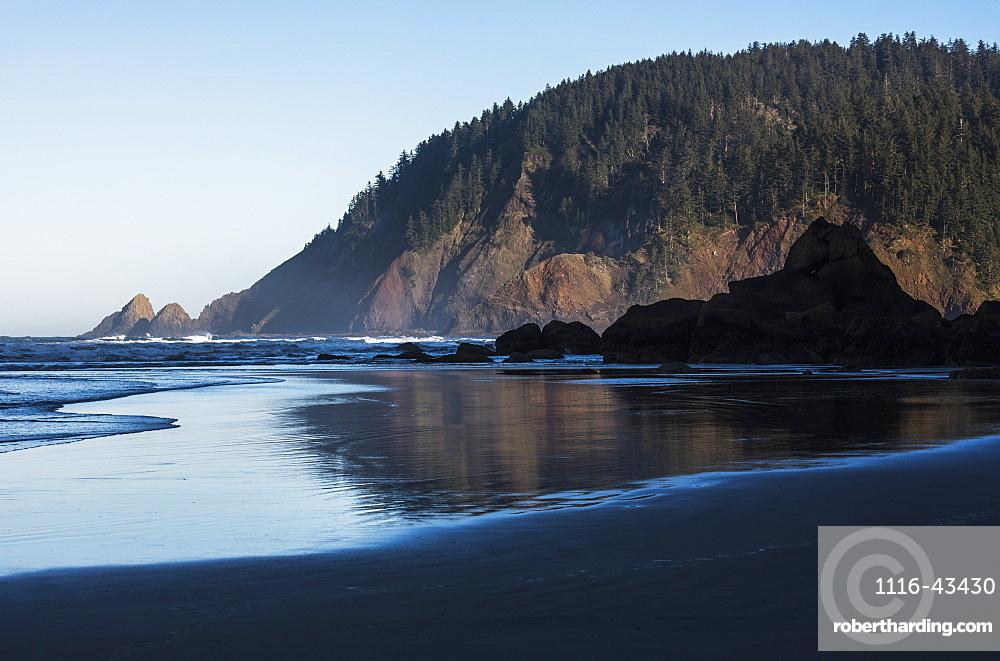 Morning Sunlight Warms Tillamook Head, Cannon Beach, Oregon, United States Of America