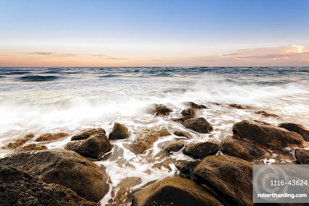 Sunset And Surf Along Rocks, Lydgate Beach, Wailua, Kauai, Hawaii, United States Of America