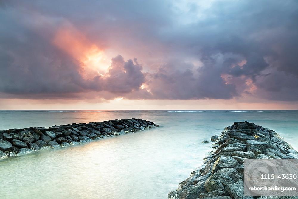 Sunrise In Kapaa Looking Out Over Breakwater, Kapaa, Kauai, Hawaii, United States Of America