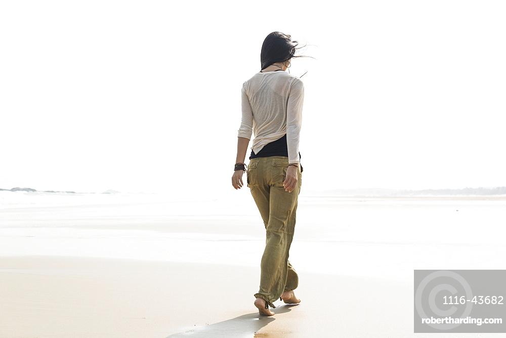 Young Woman Walking On The Beach, Huohu, Taiwan