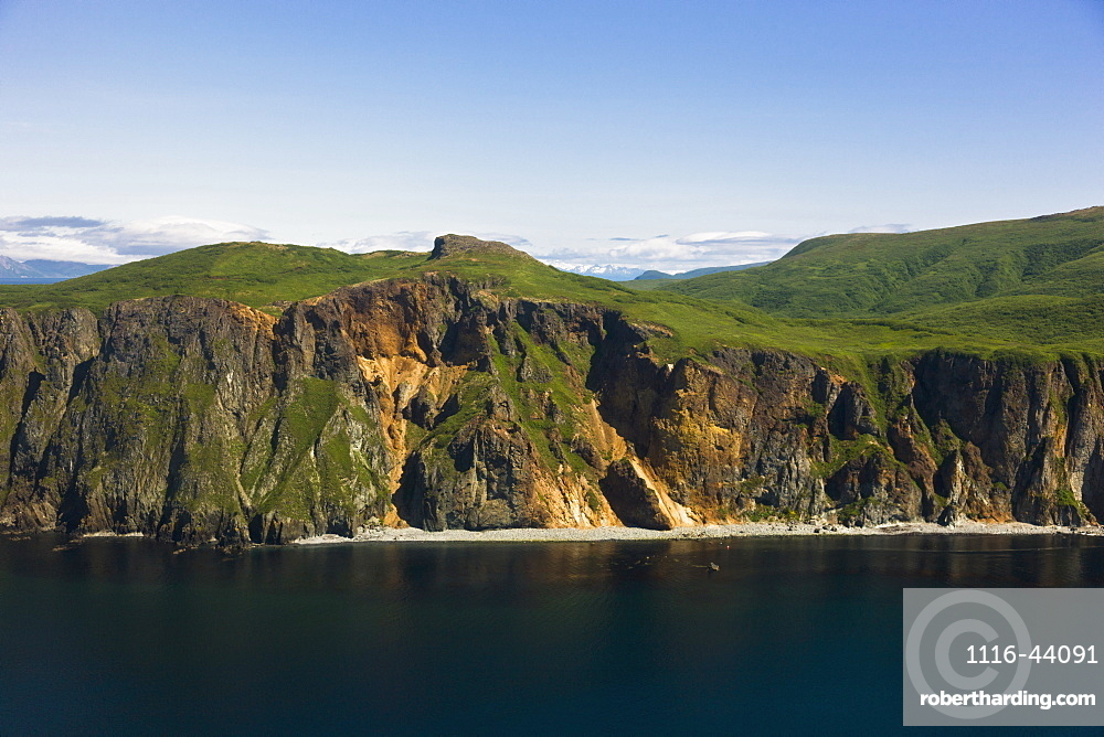 Aerial View Of Rocky Cliffs And Green Hills Along The Shore Of Popof Island Near Sand Point, Southwestern Alaska, USA, Summer