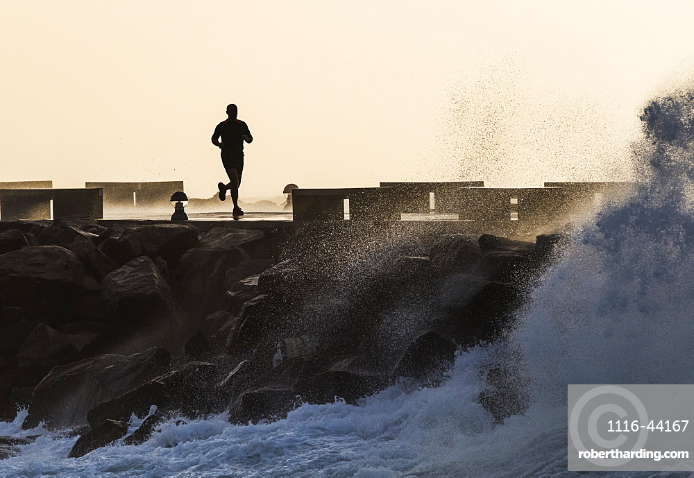Silhouette Of A Man Running Along The Coast, La Isla, Tarifa, Cadiz, Andalusia, Spain