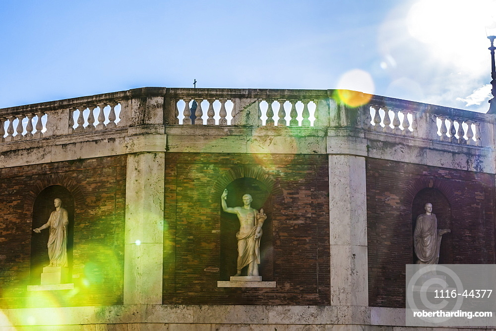 Statues In Niches On A Brick Wall With Balustrades Along The Top With Sunlight Streaming Down, Piazza Del Quirinale, Rome, Italy