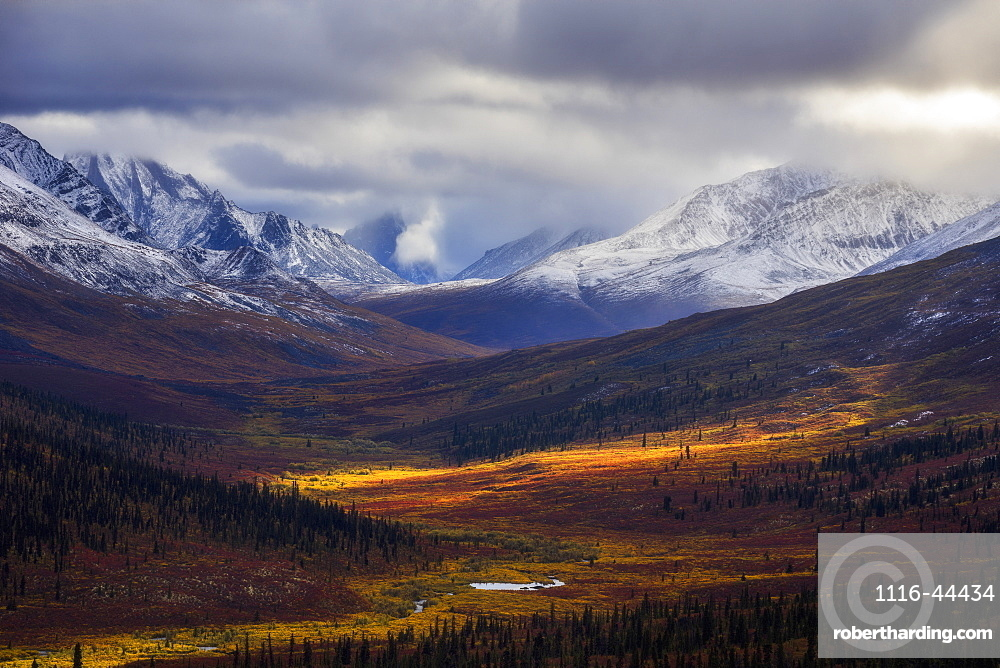 Storm Clouds Part Allowing Light To Illuminate The Landcape In The North Klondike Valley Along The Dempster Highway In Northern Yukon, Yukon, Canada