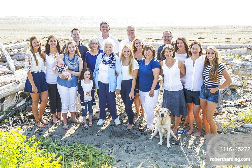 Portrait Of A Large Family On A Beach Along The Coast, Fox Spit, Whidbey Island, Washington, United States Of America