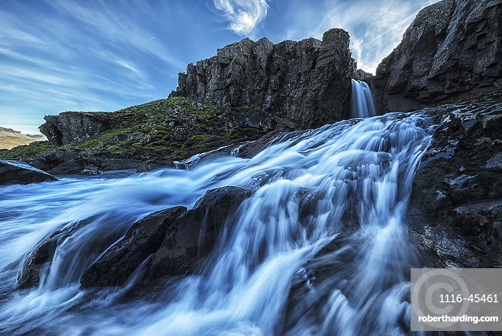 A Small Waterfall Flows Into The Ocean Along The Eastern Coast Of Iceland, Iceland